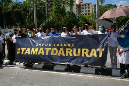 Opposition leaders hold a banner seeking to end the state of emergency outside the National Palace in Kuala Lumpur, Malaysia, 20 April 2021. Mahathir presenting a petition to the Malaysian King for an end to the state of emergency period that was declared in January 2021 due to CCOVID-19 infections rise.