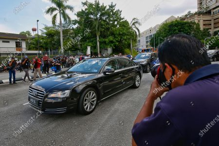 Stock Photo of A car carrying former Prime Minister Mahathir Mohamad moves into National Palace to handover a memorandum seeking to end the state of emergency in Kuala Lumpur, Malaysia, 20 April 2021. Mahathir presenting a petition to the Malaysian King for an end to the state of emergency period that was declared in January 2021 due to CCOVID-19 infections rise.