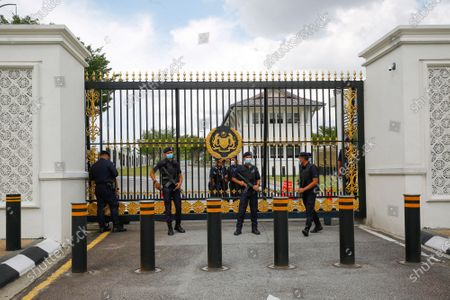 Stock Picture of Malaysian policemen guards the entrance of National Palace in Kuala Lumpur, Malaysia, 20 April 2021. Mahathir presenting a petition to the Malaysian King for an end to the state of emergency period that was declared in January 2021 due to CCOVID-19 infections rise.