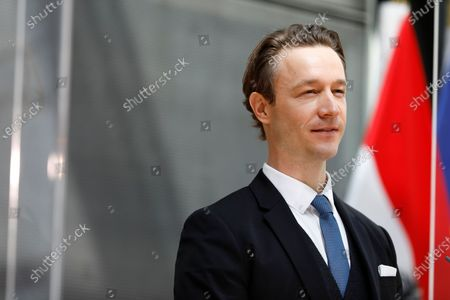 Austria's finance minister Gernot Bluemel looks positive into the future while speaking during a press conference about the political plans for the upcoming weeks in Vienna, Austria