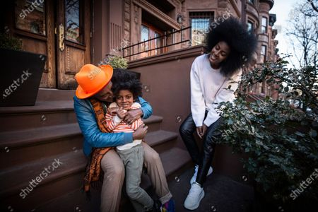 Stock Image of Chef Marcus Samuelsson with wife Maya and son Zion, 4, i Harlem in Harlem, New York