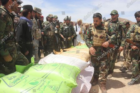 Afghan security official displays the 7,900 kilograms of ammonium nitrate bags which were recovered hidden in cement bags during an operation in Paktika province, Afghanistan, 20 April 2021. Ammonium nitrate that is highly explosive is a popular fertiliser and used in agriculture around the globe. Afghans are anticipating a surge in violence after the United States announced that it would withdraw its troops from Afghanistan by 11 September, despite Washington promising continued assistance during a surprise visit by US Secretary of State Antony Blinken.