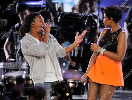 """Jennifer Hudson and Lupe Fiasco perform during """"We Day"""" at the Allstate Arena on April 30, 2015 in Rosemont, Illinois."""