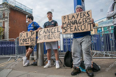 A goup of unhappy Chelsea supporters protest  with placards outside Stamford Bridge stadium against the decision by Roman Abramovich,the Russian billionaire owner of Chelsea  Football Club  to form a breakaway European Super League with other English Premier Clubs. The decision has created a backlash amongst football supporters nationwide and the government