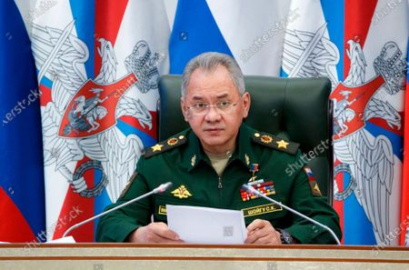 """In this photo released by Russian Defense Ministry Press Service, Russian Defense Minister Sergei Shoigu speaks at a meeting with the top military brass in Moscow, Russia, . Shoigu on Tuesday accused Ukraine of trying to destabilize the situation in eastern Ukraine and lashed out at the U.S. and NATO for what he described as """"provocative actions"""" in the Black Sea area"""
