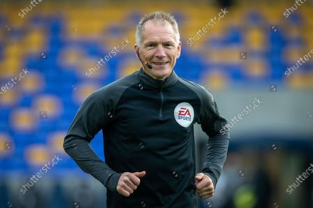 Stock Picture of Assistant referee Michael George during the EFL Sky Bet League 1 match between AFC Wimbledon and Oxford United at Plough Lane, London