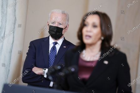 President Joe Biden listens as Vice President Kamala Harris speaks, at the White House in Washington, after former Minneapolis police Officer Derek Chauvin was convicted of murder and manslaughter in the death of George Floyd