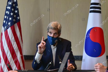 In this, file, photo provided by U.S. Embassy Seoul, U.S. special envoy for climate John Kerry speaks during a round table meeting with the media in Seoul, South Korea. Diplomats for the U.S. and China agreed to cooperate on climate change leading up to the virtual summit that begins on Earth Day. The agreement was reached by U.S. special envoy for climate Kerry and his Chinese counterpart Xie Zhenhua during two days of talks in Shanghai last week