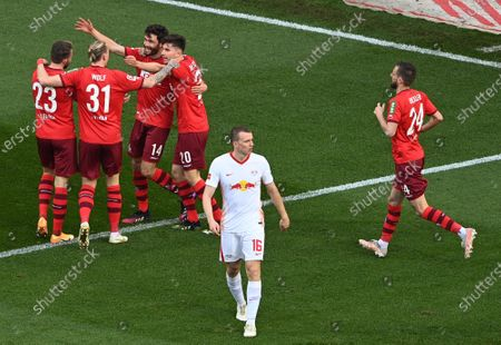 Cologne's Jonas Hector (3-L) celebrates his 1-0 goal during the German Bundesliga soccer match between FC Koeln and RB Leipzig in Cologne, Germany, 20 April 2021.