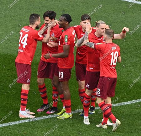Cologne's Jonas Hector (2-L) celebrates his 1-0 goal during the German Bundesliga soccer match between FC Koeln and RB Leipzig in Cologne, Germany, 20 April 2021.