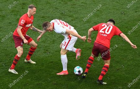 Leipzig's Marcel Halstenberg (C) in action against Cologne's Jonas Hector (L) and Cologne's Elvis Rexhbecaj (R) during the German Bundesliga soccer match between FC Koeln and RB Leipzig in Cologne, Germany, 20 April 2021.