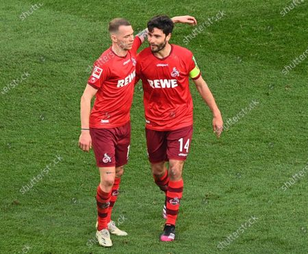Cologne's Jonas Hector (R) celebrates his 2-1 goal during the German Bundesliga soccer match between FC Koeln and RB Leipzig in Cologne, Germany, 20 April 2021.