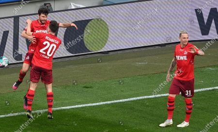 Cologne's Jonas Hector (L) celebrates his 2-1 goal during the German Bundesliga soccer match between FC Koeln and RB Leipzig in Cologne, Germany, 20 April 2021.