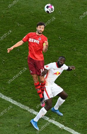 Cologne's Jonas Hector (L) in action against Leipzig's Dayot Upamecano (R) during the German Bundesliga soccer match between FC Koeln and RB Leipzig in Cologne, Germany, 20 April 2021.
