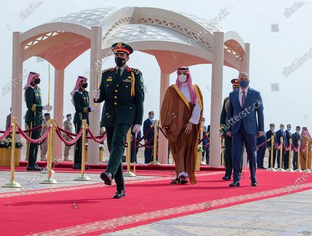 Released by the Saudi Royal Palace, Saudi Crown Prince Mohammed bin Salman, center right, accompanies Iraqi Prime Minister Mustafa al-Kadhimi on his arrival to Riyadh International Airport, Saudi Arabia. A first round of direct talks held in April 2021, in Iraq, between regional rivals Saudi Arabia and Iran is seen as a positive sign of de-escalation following years of animosity. The hosting of the talks is also a significant step for Iraq, which has ties with both the U.S. and Iran and has often borne the brunt of Saudi-Iran rivalry