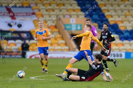 Scunthorpe United Alex Gilliead (8) makes a tackle on Mansfield Town George Maris (10) during the EFL Sky Bet League 2 match between Mansfield Town and Scunthorpe United at the One Call Stadium, Mansfield