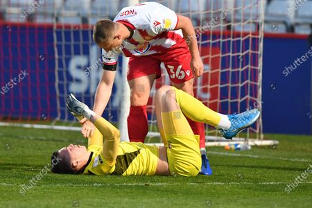 Luke Norris of Stevenage FC slides in on Josh Griffiths Of Cheltenham Town FC during Stevenage vs Cheltenham Town, Sky Bet EFL League 2 Football at the Lamex Stadium on 20th April 2021