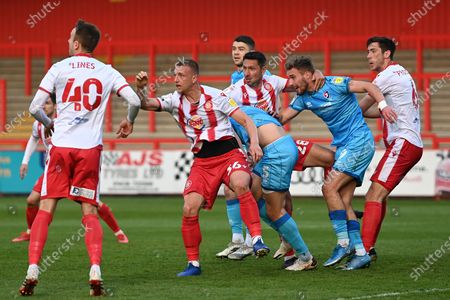 Stevenage forward Luke Norris(36) Cheltenham Town Defender Charlie Raglan(5) Stevenage defender Joe Martin(28)  Cheltenham Town Forward Sam Smith(9) and Stevenage defender Luke Prosser(6)  battles for possession during the EFL Sky Bet League 2 match between Stevenage and Cheltenham Town at the Lamex Stadium, Stevenage