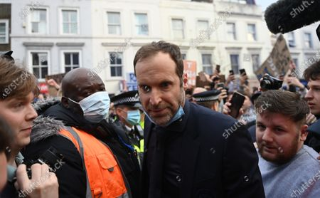 Chelsea's technical and performance advisor Petr Cech speaks to fans during demonstration against the European Super league before the English Premier League soccer match between Chelsea FC and Brighton & Hove Albion FC in London, Britain, 20 April 2021. In the early hours of 19 April 2021 twelve European soccer clubs, AC Milan, Arsenal FC, Atletico de Madrid, Chelsea FC, FC Barcelona, FC Internazionale Milano, Juventus FC, Liverpool FC, Manchester City, Manchester United, Real Madrid CF and Tottenham Hotspur have announced the creation of a Super League which would rival the excisting UEFA club competitions and has been strongly condemned by the UEFA.