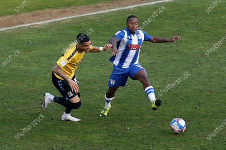 Callum Harriott of Colchester United and Louis Walsh of Southend United during Colchester United vs Southend United, Sky Bet EFL League 2 Football at the JobServe Community Stadium on 20th April 2021