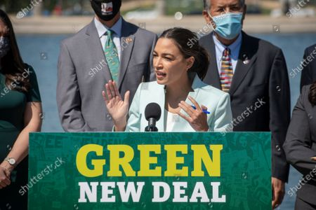 United States Representative Alexandria Ocasio-Cortez (Democrat of New York) offers remarks during a press conference to re-introduce the Green New Deal in front of the US Capitol in Washington, DC,.