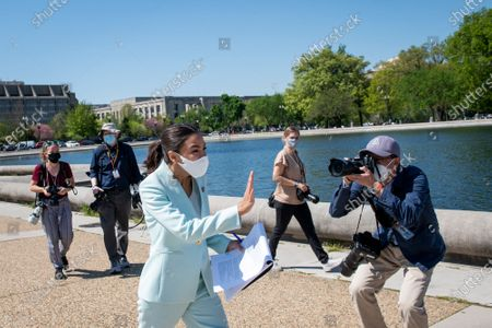 United States Representative Alexandria Ocasio-Cortez (Democrat of New York) arrives for a press conference to re-introduce the Green New Deal in front of the US Capitol in Washington, DC,.