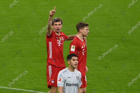 Bayern's Joshua Kimmich celebrates with Bayern's Thomas Mueller after scoring his side's second goal during the German Bundesliga soccer match between Bayern Munich and Bayer Leverkusen at the Allianz Arena stadium in Munich, Germany