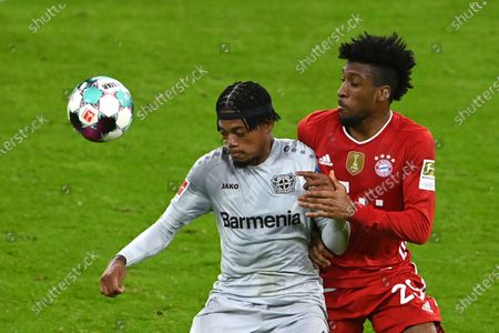 Leverkusen's Leon Bailey, left, challenges for the ball with Bayern's Kingsley Coman during the German Bundesliga soccer match between Bayern Munich and Bayer Leverkusen at the Allianz Arena stadium in Munich, Germany