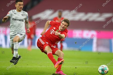 Bayern's Thomas Mueller takes a shot at goal during the German Bundesliga soccer match between Bayern Munich and Bayer Leverkusen at the Allianz Arena stadium in Munich, Germany