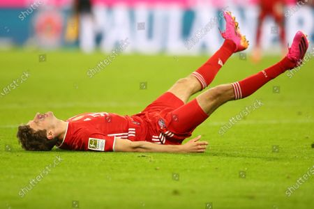 Bayern's Thomas Mueller falls after failing to score during the German Bundesliga soccer match between Bayern Munich and Bayer Leverkusen at the Allianz Arena stadium in Munich, Germany