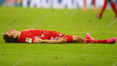Bayern's Thomas Mueller lies on the pitch after failing to score during the German Bundesliga soccer match between Bayern Munich and Bayer Leverkusen at the Allianz Arena stadium in Munich, Germany