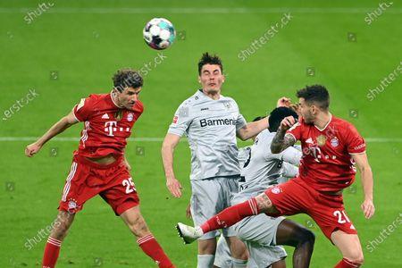 Bayern's Thomas Mueller, left, jumps for a header with Leverkusen's Patrik Schick during the German Bundesliga soccer match between Bayern Munich and Bayer Leverkusen at the Allianz Arena stadium in Munich, Germany