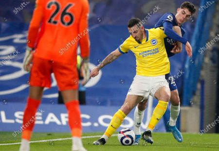 Brighton's Lewis Dunk, center, duels for the ball with Chelsea's Kai Havertz during the English Premier League soccer match between Chelsea and Brighton and Hove Albion at Stamford Bridge Stadium in London