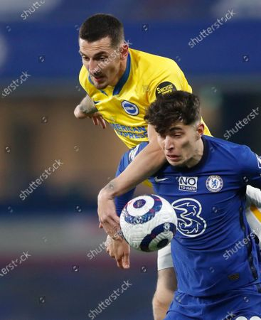 Chelsea's Kai Havertz, front, duels for the ball with Brighton's Lewis Dunk during the English Premier League soccer match between Chelsea and Brighton and Hove Albion at Stamford Bridge Stadium in London