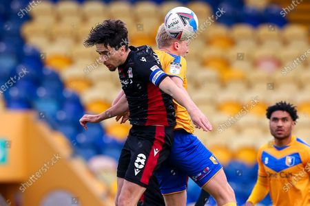 Stock Photo of Alex Gilliead of Scunthorpe United and George Lapslie of Mansfield Town jump to heÕd the ball