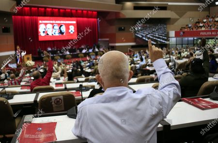 Attendees to the VIII Congress of the Communist Party of Cuba approve the central report during the congress in Havana, Cuba 18 April 2021. Delegates to the VIII Congress of the Communist Party of Cuba (PCC, the only legal one) approved five resolutions this Sunday, including the Central Report, the last one issued by the entity's first secretary, Raul Castro, before handing over to the president. of the country, Miguel Diaz-Canel.