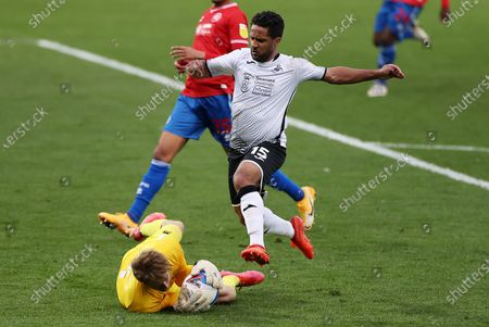 Wayne Routledge of Swansea City canÕt get to the ball before Joe Lumley of QPR.