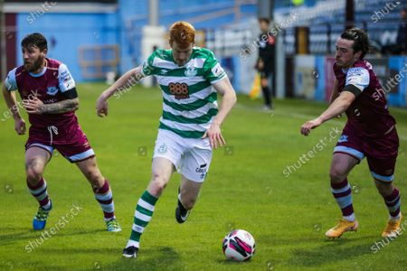 Drogheda United vs Shamrock Rovers . Drogheda United's Gary Deegan and James Brown with Rory Gaffney of Shamrock Rovers