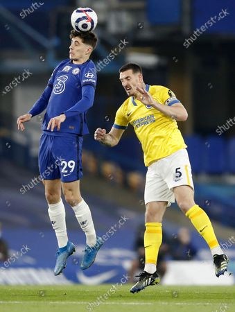 Kai Havertz (L) of Chelsea in action against Lewis Dunk (R) of Brighton during the English Premier League soccer match between Chelsea FC and Brighton & Hove Albion FC in London, Britain, 20 April 2021.