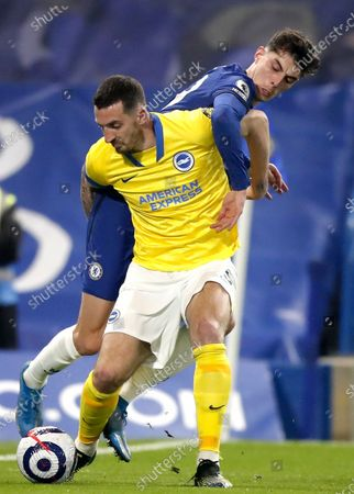 Kai Havertz (back) of Chelsea in action against Lewis Dunk (front) of Brighton during the English Premier League soccer match between Chelsea FC and Brighton & Hove Albion FC in London, Britain, 20 April 2021.