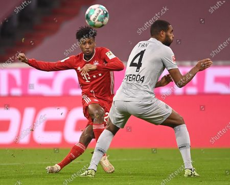Bayern's Kingsley Coman (L) in action against Leverkusen's Jonathan Tah (R) during the German Bundesliga soccer match between FC Bayern Munich and Bayer 04 Leverkusen in Munich, Germany, 20 April 2021.