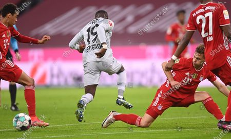 Leverkusen's Moussa Diaby (L) in action against Bayern's Joshua Kimmich (R) during the German Bundesliga soccer match between FC Bayern Munich and Bayer 04 Leverkusen in Munich, Germany, 20 April 2021.