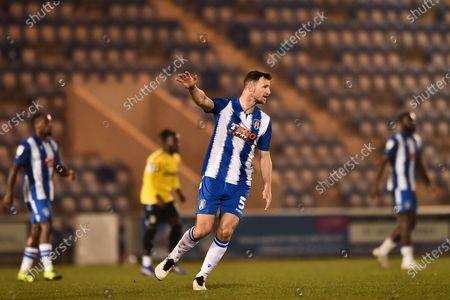 Stock Photo of Colchester United's Thomas Smith (5) pointing, directing, signalling, gesture during the EFL Sky Bet League 2 match between Colchester United and Southend United at the JobServe Community Stadium, Colchester
