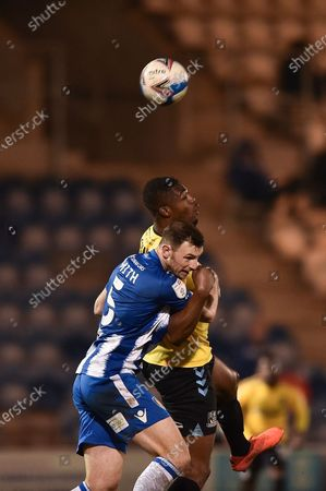 Colchester United's Thomas Smith (5) and Southend United Emile Acquah (18) head the ball during the EFL Sky Bet League 2 match between Colchester United and Southend United at the JobServe Community Stadium, Colchester
