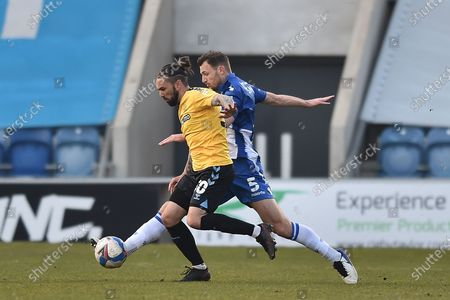 Southend United Ricky Holmes (30) and Colchester United's Thomas Smith (5) battle for possession during the EFL Sky Bet League 2 match between Colchester United and Southend United at the JobServe Community Stadium, Colchester