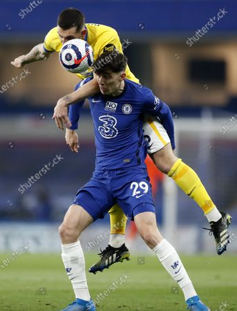 Kai Havertz (front) of Chelsea in action against Lewis Dunk (back) of Brighton during the English Premier League soccer match between Chelsea FC and Brighton & Hove Albion FC in London, Britain, 20 April 2021.