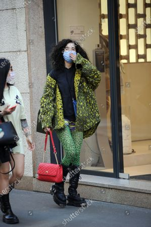 Stock Image of Chiara Scelsi shopping in the center with friend Chiara Scelsi, model muse of Dolce & Gabbana, strolls through the streets of the center with a friend after shopping. Before returning home, Chiara Scelsi is recognized by a boy who wants to sell her socks.
