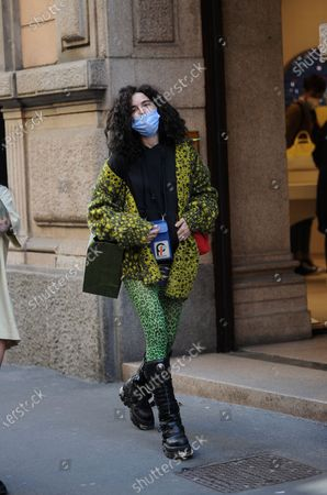 Stock Picture of Chiara Scelsi shopping in the center with friend Chiara Scelsi, model muse of Dolce & Gabbana, strolls through the streets of the center with a friend after shopping. Before returning home, Chiara Scelsi is recognized by a boy who wants to sell her socks.