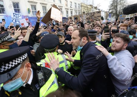 Stock Image of Petr Cech talks with Chelsea Fans as they protests against the proposed European Super League ahead of the teams game against Brighton at Stamford Bridge Stadium