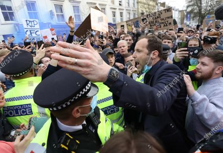 Stock Photo of Petr Cech talks with Chelsea Fans as they protests against the proposed European Super League ahead of the teams game against Brighton at Stamford Bridge Stadium